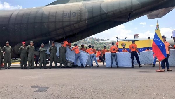 Volunteerembers Of The Venezuelan Air Force Ready A Plane Equipped With Humanitarian Aid For Hurricane Ravaged Caribbean Island Dominica