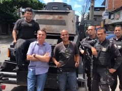 President-elect Jair Bolsonaro (center to left) poses with military police in the Rio de Janeiro neighborhood of Cidade de Deus