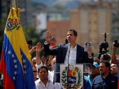 National Assembly President Juan Guaido swears himself in at an opposition rally in east Caracas on January 23, 2019