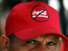 "A former Coca-Cola employee wears a cap which reads ""Don't drink Coca-cola"" during a protest in Caracas October 23, 2006. Former employees took over several Coca-Cola Co. bottling plants in the country and blocked delivery trucks from leaving on Monday to"