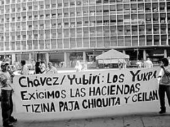 "A protest sign in support of the Yukpa reads: ""Chávez/[Environment Minister] Yubirí: The Yukpa demand the Tizina, Paja, Chiquita, and Ceilan Estates."" (ANMCLA)"