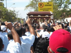The arrival of one of the coffins for the killed workers at the Mitsubishi plant. (Archive)
