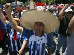 Supporters of Manuel Zelaya in Tegucigalpa today (Esteban Felix/AP)