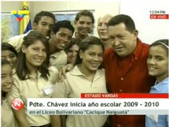 President Hugo Chavez with students during the inauguration of a new public high school on Wednesday (VTV)