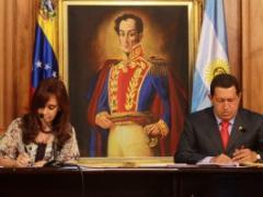 Presidents Cristina Fernandez and Hugo Chavez sign bilateral accords (ABN)