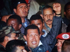 President Chavez returns to the presidential palace following the coup