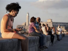 Woman using cellphone in Havana