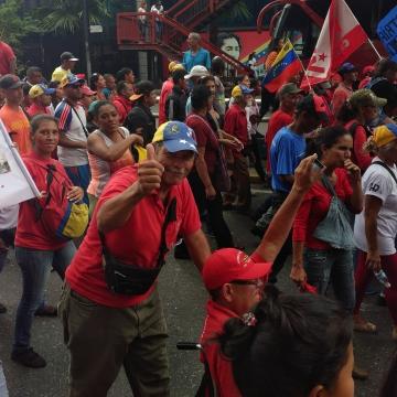 Chavistas march down Urdaneta Avenue in downtown Caracas