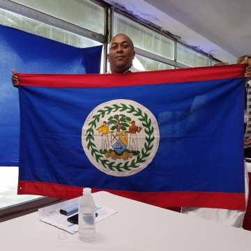 "Garfield Murrillo of the Belize-Venezuela Solidarity Committee holds the Belizean flag during ""Sundays with Maduro"""