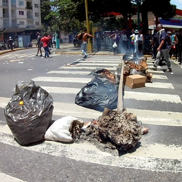 Rubbish bags and trees were used to prepare barricades in Altamira, where people gathered to support the coup. (Katrina Kozarek)