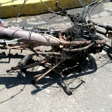A motorbike - most likely of a government supporter - was burnt and then used to strengthen the barricades. (Katrina Kozarek)