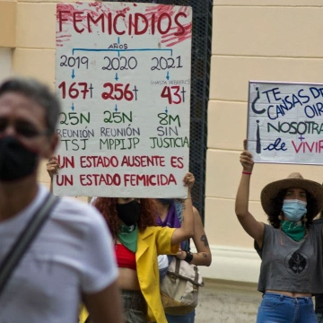 "Femicides have mostly gone unpunished in recent years, causing largescale social outcry. Here a placard shows the number of femicides in the country in recent years, stating that ""An absent state is a femicidal state."" On the right, the other placard reads ""You are bored of hearing about it? Well we are bored of living with it."" (Bernardo Suarez)"