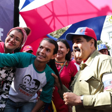 Young people from the Fabricio Ojeda Youth Brigade snap a selfie with President Maduro