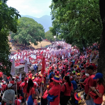 The streets were overflowed with Maduro supporters, forcing people to take to the sidewalks, grassy knolls, and even the trees. (Katrina Kozarek)