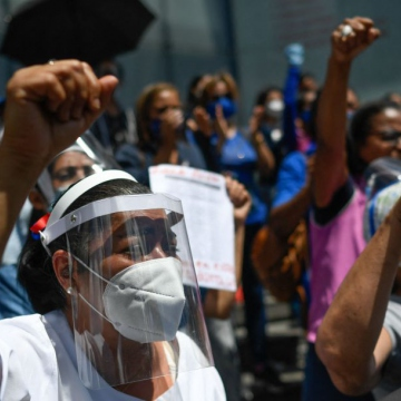 Opposition-led activities were also seen, with these women demanding higher pay outside the UN Development Program's offices in Caracas. (Federico Parra / AFP)