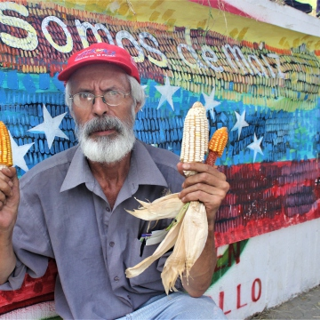 Local poet armed with native corn seeds