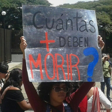 "Sign reads, ""How many more have to die?"" (Los Inquilinos Venezolanos)"