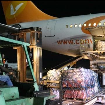 Venezuelan aid to Haiti is unloaded Sunday night at the Toussaint Louverture International Airport in Port-au-Prince. (MPPRE Venezuela)