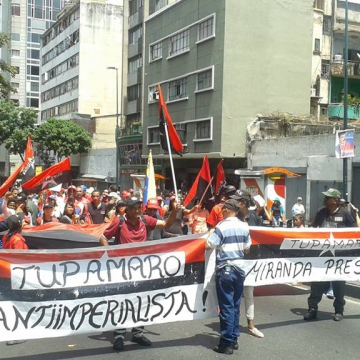 Workers march against imperialist aggression on May Day 2018 (Credit: Ricardo Vaz/Investig'Action ENG)