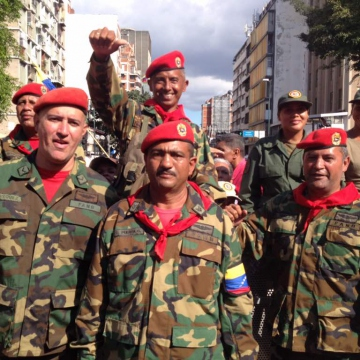 Venezuelan military personnel manifest their loyalty to late President Hugo Chavez and his successor, Nicolas Maduro