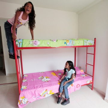 Here two young girls enjoy getting to know their new room (AVN).