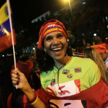 A women at a victory street party in central Caracas after the result was announced (AVN)