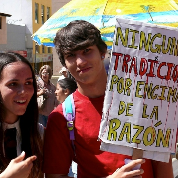 """""""No tradition above reason"""" reads this placard at the Merida anti-bullfighting march (Fermin E Osorio)"""