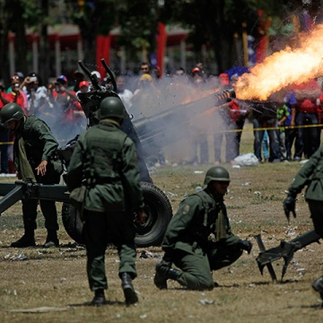 Soldiers fired a cannon outside. (Rodrigo Abd/AP)