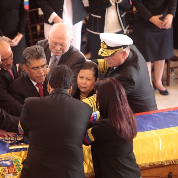 Venezuelan officials join hands. (AP Photo/Miraflores Press Office)