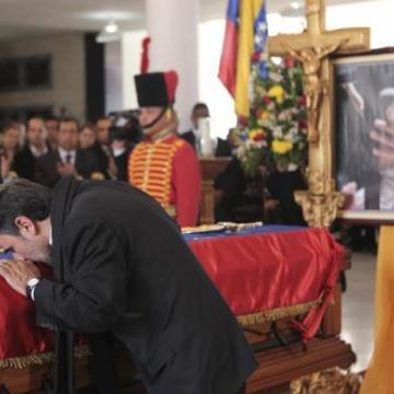 Iranian President Mahmoud Ahmadinejad pays his respects. (Reuters)