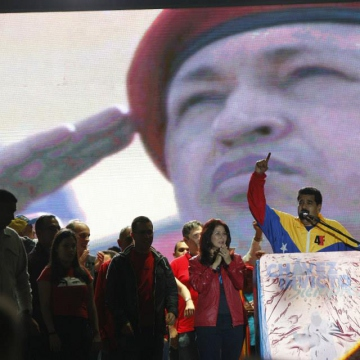 President Nicolas Maduro addressing a crowd for supporters outside the Military Academy where Chavez's funeral took place as part of events to mark the one year anniversary of Hugo Chavez's final campaign rally in Caracas on 4 October 2012. (Prensa Miraflores)