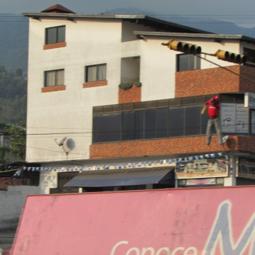 Atop another barricade further down Las Americas Avenue, another hanging chavista doll swings in the wind.