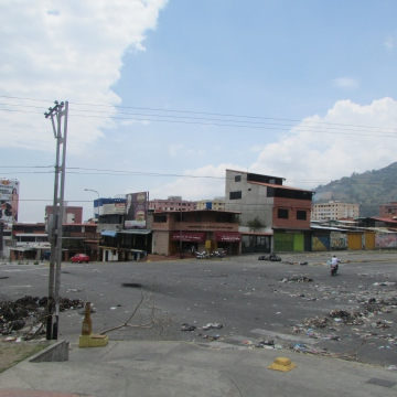 Also on 15 March. This is the city intersection, next to the Yuan Lin supermarket, photographed with opposition student activists several weeks earlier (see above, picture four). The intersection is now strewn with rudimentary barricades and burnt rubbish. Keen observers will also notice that the yellow traffic light post on the nearest corner is now missing. Every now and then militants venture out from nearby barricades to charge passing cars money in order to be able to pass. Several buses and taxis have also been stolen and kept hostage in order to force the suspension of transport services, which generally reactivate again after a day or two.