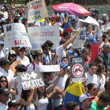 """This photo, taken 18 February, is of one of several large opposition protests that took place in Mérida at the peak of the unrest. Protesters complained about persistent shortages in some basic foodstuffs, high crime and inflation, corruption, and alleged Cuban """"intervention"""" in Venezuelan affairs. Many demonstrators also called for the government's resignation. Chants heard by this journalist included """"we don't want a dictatorship like Cuba's"""" and """"this government is going to fall""""."""