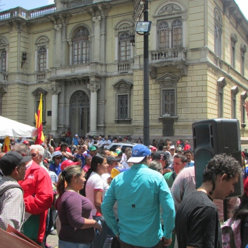 """Meanwhile government supporters, or chavistas, began holding daily assemblies in the city's main square to counteract the opposition protests and barricades. Speeches, poetry and music were performed. Curiously, while several main city avenues became permanently cut off by barricades, the centre and main thouroughfares into the city remained largely unaffected, with transport services running as normal and schools and businusses generally remaining open in unaffected areas. This situation evoked the idea of a """"tale of two cities"""", where those in affected areas saw life ground to a standstill, while those in areas unaffected by barricades continued life as normal."""