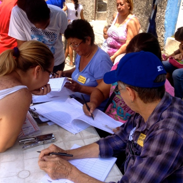 While others worked to check the voter's name and I.D. against the community census before giving them a voting card (Rachael Boothroyd Rojas - Venezuelanalysis)