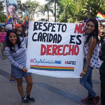 """Respect is not charity, it's a right"" reads the banner of two young women from the state of Carabobo. (Jeanette Charles/Venezuela Analysis)"