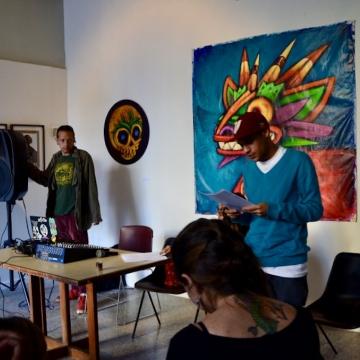 Poet Alejandro Indriago reads a poem by Cuban poet Nicolas Guillen (Rachael Boothroyd Rojas/Venezuelanalysis.com)
