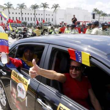 The motorcade began outside the National Military Academy in Caracas' historic Park of Heroes.