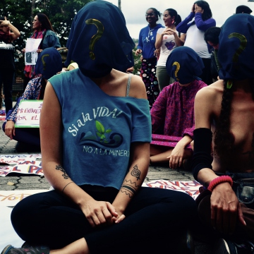 Women used hoods to depict how femicide is ignored, while its victims are made invisible. (Rachael Boothroyd Rojas/Venezuelanalysis)