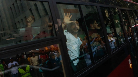 A number of those released are transported to the centre of Caracas by authorities