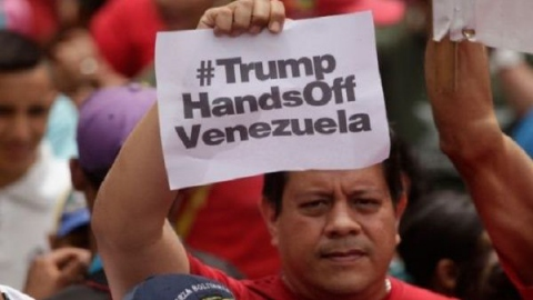 Venezuelans protest US sanctions against their country.