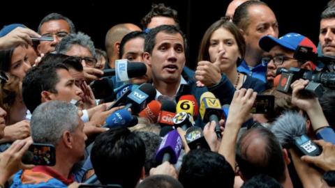 "Venezuela's self-proclaimed ""interim president,"" Juan Guaido, speaks to reporters. (Luis Robayo)"