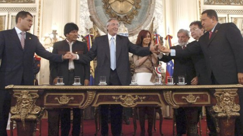 Leaders from Six South American nations celebrate after signing the founding act for the Bank of the South (AP)