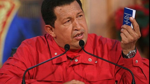 President Chavez holds up a copy of the 1999 constitutiona, which he wanted to reform (Alfonso Ocando/Prensa Presidencial)