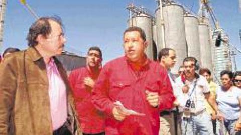 Venezuelan President Hugo Chavez and Nicaraguan President Daniel Ortega during the inauguration of a corn processing plant on Sunday. (LA PRENSA/AP)
