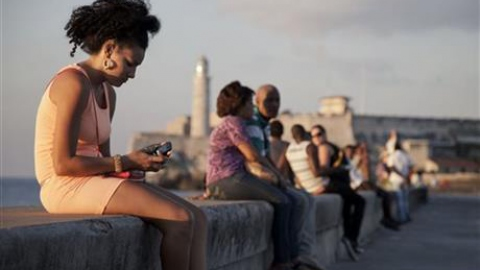 Woman using cellphone in Havana