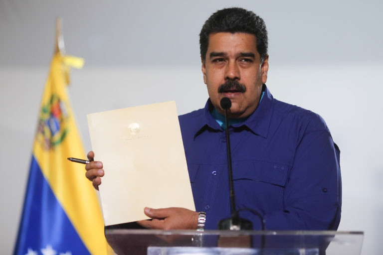 "Venezuelan President Nicolas Maduro signs a ""democratic coexistence"" agreement with the opposition, despite the latter refusing to ratify the accord"