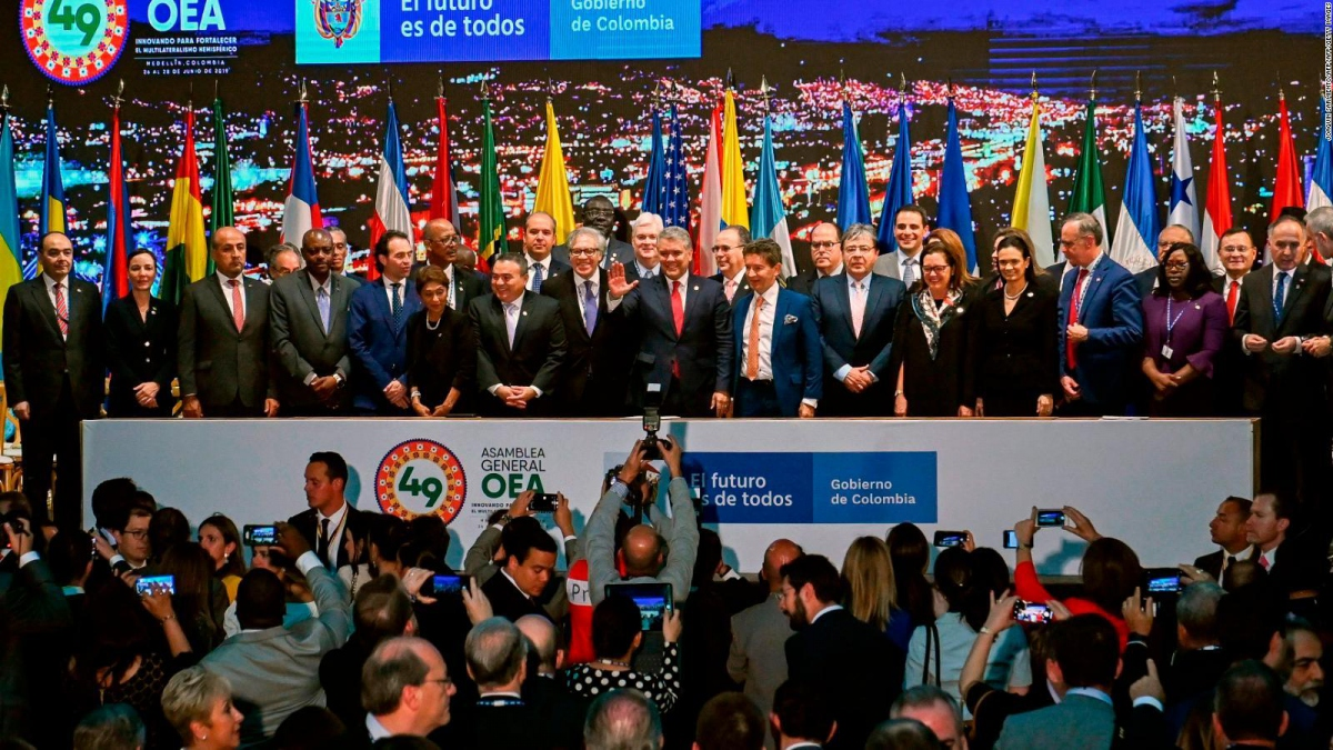 OAS delegates pose for a photo in Medellin, Colombia, including controversial right wing politician Julio Borges (eighteenth from the left) for Venezuela. (CNN)