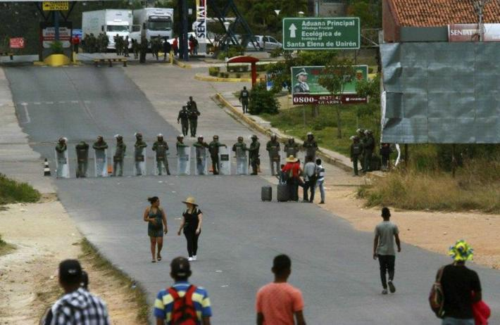 Venezuelan soldiers patrol the Brazilian border that the Venezuelan government ordered closed on Friday (AP)